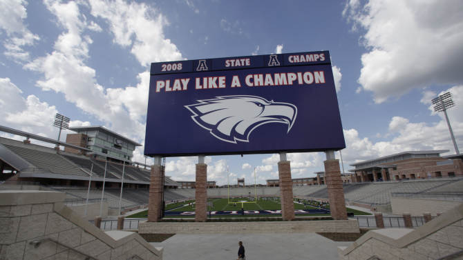The scoreboard is shown at the new $60 million football stadium at Allen High School Tuesday, Aug. 28, 2012 in Allen, Texas. Allen High School northeast of Dallas christens the stadium Friday night with a matchup against defending state champion Southlake Carroll. While other school districts are struggling to retain teachers and keep classroom sizes down, Allen voters approved a $119 million bond issue that pays for the stadium and other district facilities. (AP Photo/LM Otero)