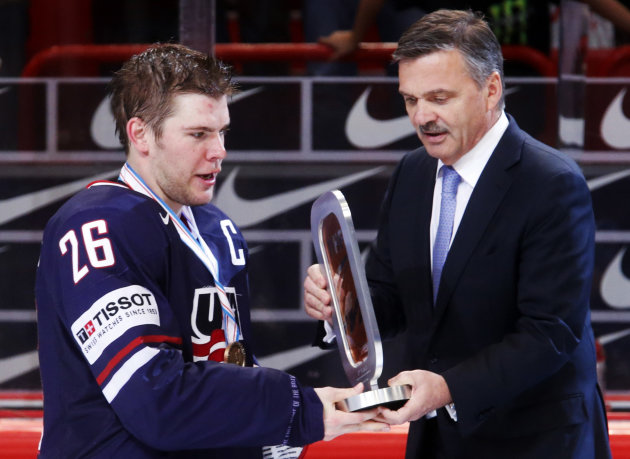 IIHF President Rene Fasel presents the bronze medal to Team USA's Stastny after their 2013 IIHF Ice Hockey World Championship bronze medal match win against Finland at the Globe Arena in Stockholm