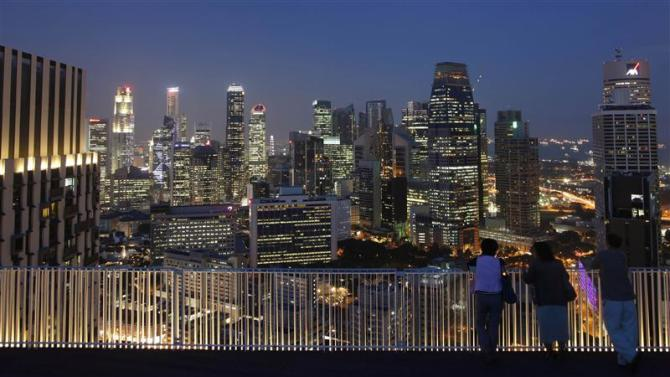 File photo of people looking at the skyline of the central business district in Singapore