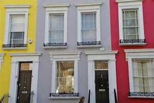A woman walks along a residential street in Notting Hill in central London