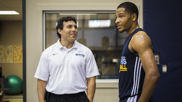 Josh Pastner, University of Memphis head coach, men's basketball, chats with Geron Johnson, a guard from University of Memphis, during a draft workout at the Memphis Grizzlies practice court at FedExForum Monday,  June 16, 2014