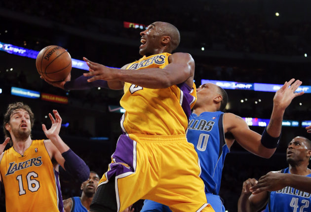 Los Angeles Lakers&#39; Kobe Bryant, center, shoots against Dallas Mavericks&#39; Shawn Marion (0) as Elton Brand (42) and Lakers&#39; Pau Gasol (16) watch in the first half of an NBA basketball game in Los Angeles, Tuesday, Oct. 30, 2012. (AP Photo/Jae C. Hong)