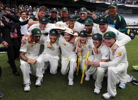 Australia's players pose for pictures after winning the Ashes test cricket series against England at the WACA ground in Perth December 17, 2013. REUTERS/David Gray