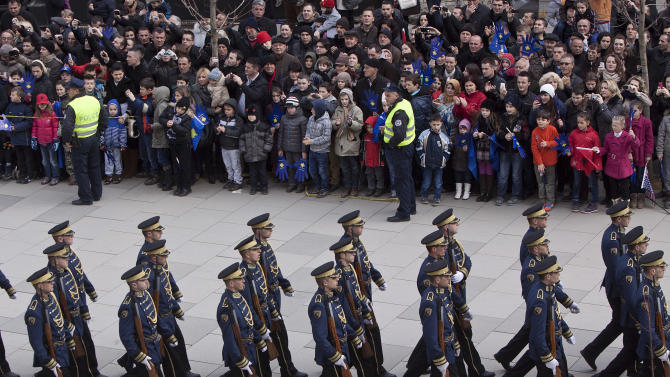 A Kosovo Security Force honor guard parades in the center of Pristina marking the 5th anniversary since Kosovo seceded from Serbia on Sunday, Feb. 17, 2013. Serbia rejects Kosovo's independence. (AP Photo/Visar Kryeziu)