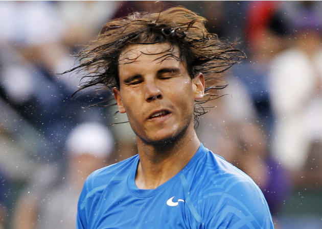 Rafael Nadal of Spain shakes the sweat off his hair after defeating compatriot Marcel Granollers in their match at the Indian Wells ATP tennis tournament in Indian Wells, California