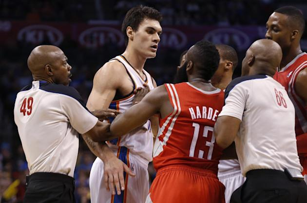 Officials Tom Washington (49) and Haywoode Workman (66) move in to separate Oklahoma City Thunder center Steven Adams (12) and Houston Rockets guard James Harden (13) during the third quarter of an NB