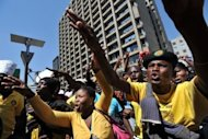 Supporters of African National Congress (ANC) Youth League leader Julius Malema protest in Johannesburg on September 12. Police issued an arrest warrant for Malema, a former ANC Youth League leader, on Friday shortly after he seized on unrest at South Africa's mines to launch political attacks against President Jacob Zuma