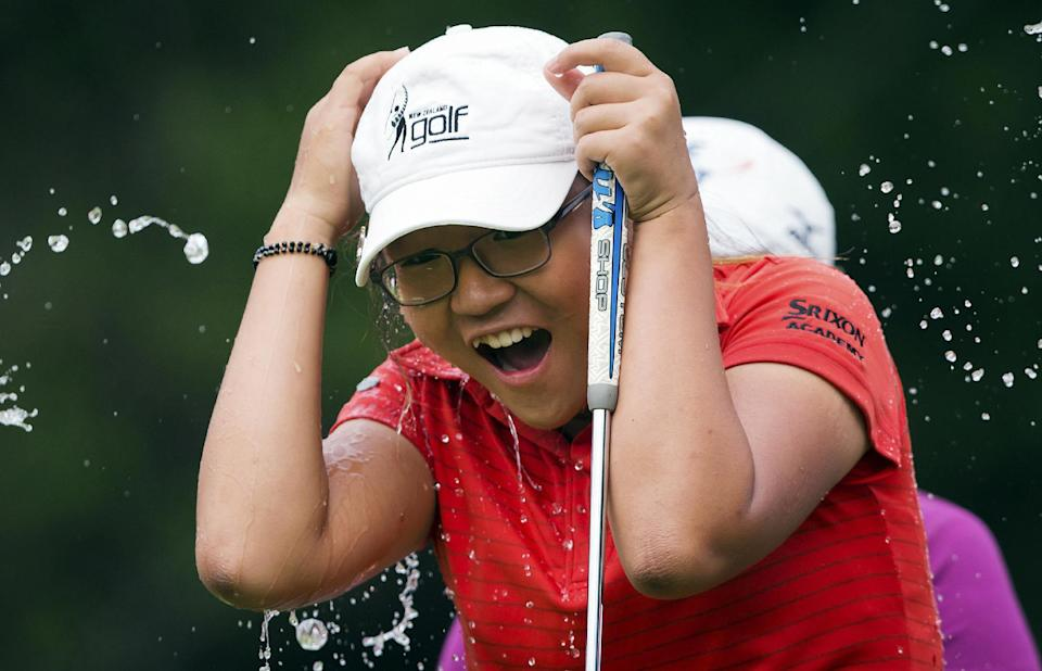 Lydia Ko, of New Zealand, is doused by fellow golfers after winning the LPGA Tour's Canadian Women's Open golf tournament, Sunday, Aug. 26, 2012, at the Vancouver Golf Club in Coquitlam, British Columbia. (AP Photo/The Canadian Press, Darryl Dyck)