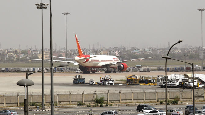 A state-run Air India aircraft sits on a tarmac at the Indira Gandhi International airport in New Delhi, India , Wednesday, May 9, 2012. A court on Wednesday declared a strike by some Air India pilots as illegal, triggered by unpaid salaries and a dispute on training on flying new generation B-787 Dreamliner aircraft. (AP Photo/Manish Swarup)