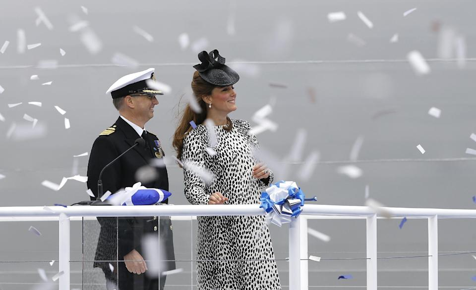 Britain's Kate, the Duchess of Cambridge smiles alongside Captain Tony Draper during a naming ceremony for the Royal Princess cruise ship in Southampton, England  Thursday, June 13, 2013. (AP Photo/Kirsty Wigglesworth)