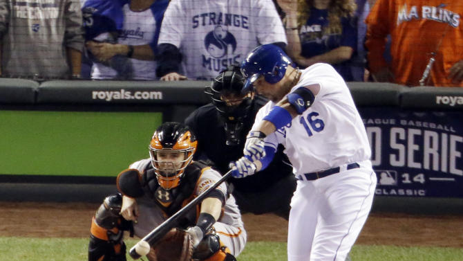 Kansas City Royals' Billy Butler hits an RBI single during the first inning of Game 2 of baseball's World Series against the San Francisco Giants Wednesday, Oct. 22, 2014, in Kansas City, Mo. (AP Photo/Charlie Riedel)