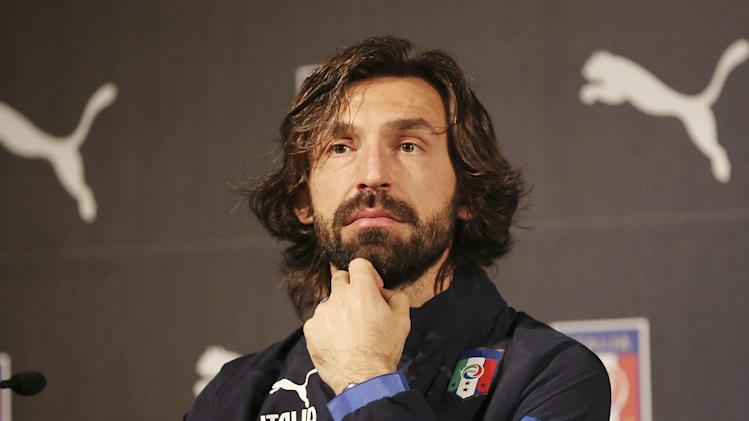 Italy Andrea Pirlo  listens to reporters' questions during a press conference for the presentation of the new Italy soccer team jersey, in Milan, Italy, Monday, March 3, 2014.  Mario Balotelli is out injured and Daniele De Rossi has been dropped due to a code of ethics violation for Italy's friendly at World Cup holder Spain on Wednesday. Missing two key starters, coach Cesare Prandelli gave Torino forward Ciro Immobile and Parma defender Gabriel Paletta their first call ups to Italy's squad on Sunday