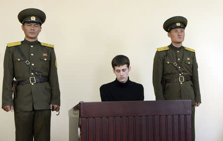 U.S. citizen Matthew Todd Miller sits in a witness box during his trial at the North Korean Supreme Court