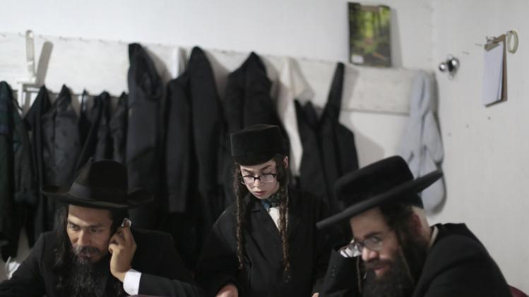 Members of a Jewish community are seen together at their home in the village of San Juan La Laguna