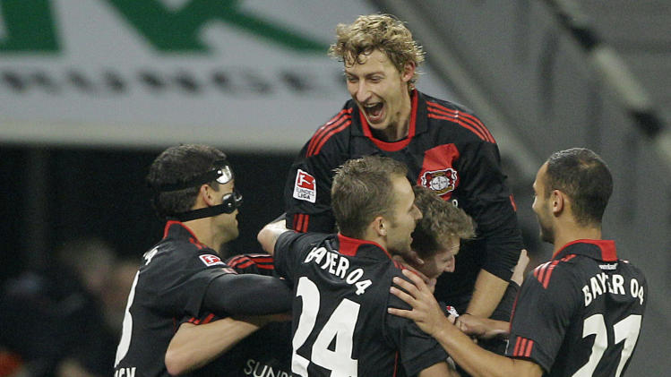 Leverkusen's teammates celebrate after scoring  during the German first division Bundesliga soccer match between Bayer 04 Leverkusen and Hamburg SV  Saturday, Nov. 5, 2011 in Leverkusen, Germany. (AP Photo/Frank Augstein) - NO MOBILE USE UNTIL 2 HOURS AFTER THE MATCH, WEBSITE USERS ARE OBLIGED TO COMPLY WITH DFL-RESTRICTIONS, SEE INSTRUCTIONS FOR DETAILS -