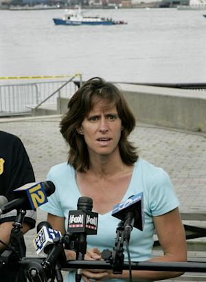 FILE - In this Saturday, Aug. 8, 2009 file photograph, Hoboken Mayor, Dawn Zimmer speaks to the media as she stands near the Hudson River in Hoboken, N.J. Zimmer, mayor of a New Jersey city that sustained severe flooding from Hurricane Sandy claims the Christie administration withheld millions of dollars in recovery grants because she refused to sign off on a politically connected development. MSNBC first reported her comments Saturday. (AP Photo/Mel Evans,file)