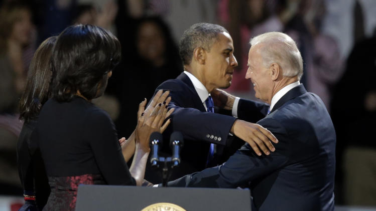 President Barack Obama hugs Vice President Joe Biden at his election night party Wednesday, Nov. 7, 2012, in Chicago. President Obama defeated Republican challenger former Massachusetts Gov. Mitt Romney. (AP Photo/Chris Carlson)