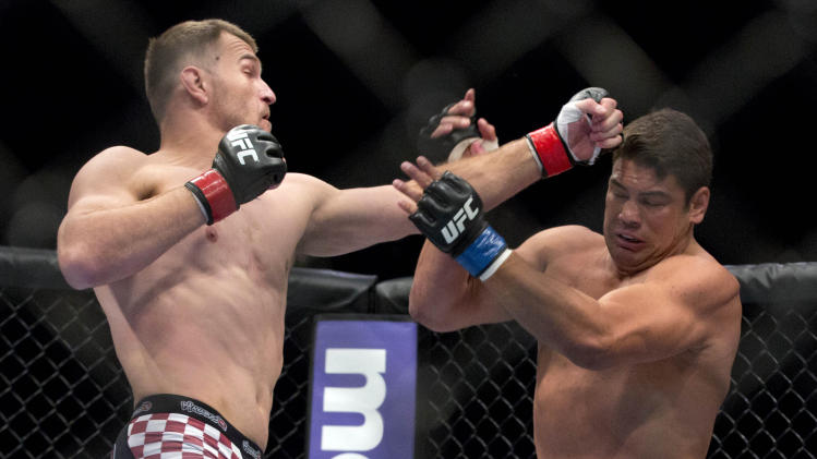 Stipe Miocic, left, throws punches against Shane Del Rosario during a UFC 146 heavyweight bout on Saturday, May 26, 2012, in Las Vegas. Miocic won by knockout in the second round. (AP Photo/Julie Jacobson)