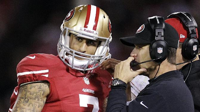 San Francisco 49ers quarterback Colin Kaepernick (7) talks with head coach Jim Harbaugh during the first half of an NFL football game against the Chicago Bears in San Francisco, Monday, Nov. 19, 2012. (AP Photo/Tony Avelar)