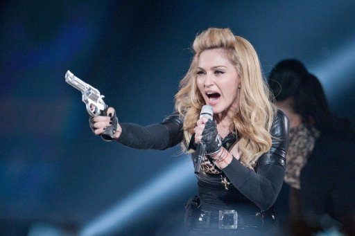 <p>US pop-star Madonna performs during her current world tour on July 7. France's far-right National Front says it plans to sue Madonna over a video at the US pop star's concert in France showing party leader Marine Le Pen with a swastika on her forehead.</p>