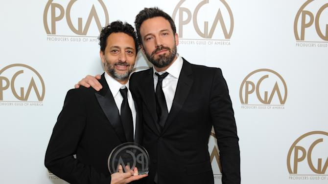 Producers Grant Heslov, left, and Ben Affleck pose backstage at the 24th Annual Producers Guild (PGA) Awards at the Beverly Hilton Hotel on Saturday Jan. 26, 2013, in Beverly Hills, Calif. (Photo by Jordan Strauss/Invision for Producers Guild/AP Images)