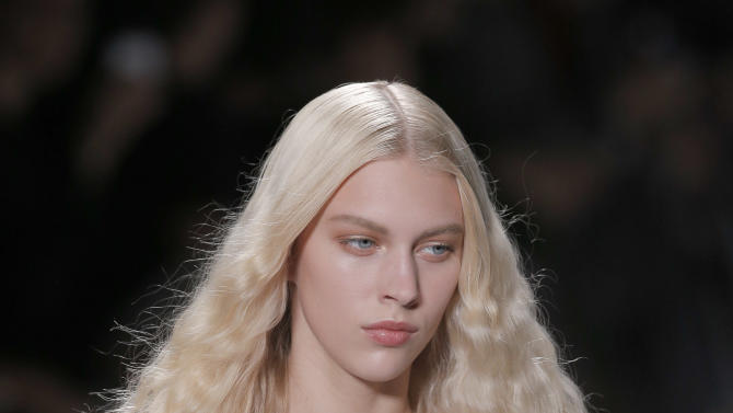 A model wears a creation for fashion designers Viktor and Rolf's ready to wear Spring-Summer 2013 collection, presented in Paris, Saturday, Sept. 29, 2012. (AP Photo/Francois Mori)