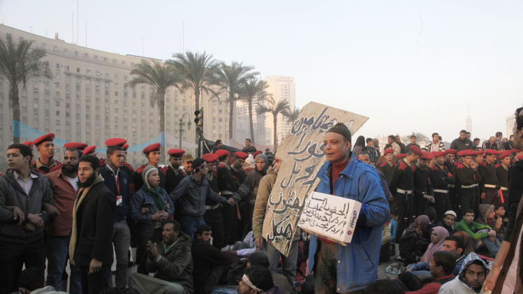 Egyptian army soldiers surround remaining protesters on Tahrir Square as the military tries to help people return to normal life in Cairo, Egypt, Sunday morning, Feb.13, 2011. Protesters were debating whether to lift their 24-hour-a-day demonstration camp in Tahrir.  (AP Photo/Manoocher Deghati)