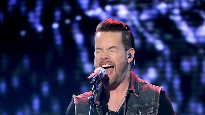 Singer David Cook performs onstage at FOX's American Idol Season 12 Top 4 To 3 Live Elimination Show on Thursday, May 2, 2013 in Hollywood, California. (Photo by Frank Micelotta/Invision for FOX/AP Images)