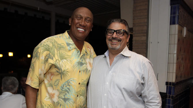 IMAGE DISTRIBUTED FOR WGN AMERICA - Chicago Cubs legend Fergie Jenkins, left, with Tribune Broadcasting President of Sales Julio Marenghi during the WGN America Spring Training Weekend Welcome Reception at the Phoenician Resort in Scottsdale, AZ. on Thursday, March 21, 2013.  (Rick Scuteri/AP Images for WGN America)