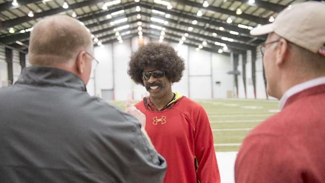 """Leon Sandcastle, NFL Network's fictional character and """"next rookie sensation"""" visits with Kansas City Chiefs General Manager John Dorsey and head coach Andy Reid on Thursday, March 28th at the University of Kansas Hospital Training Complex in Kansas City, Mo.  (G. Newman Lowrance/AP Images for NFL Network)"""