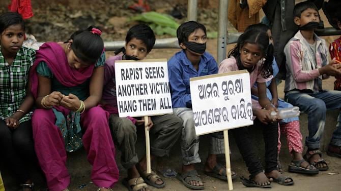 "Indian children participate in a protest against child abuse and rising crimes against women, in Bhubaneswar, India, Saturday, March 16, 2013. India has seen outrage and widespread protests against rape and attacks on women and minors since a fatal gang-rape of a young woman in December on a moving bus in New Delhi, the capital. In the most recent case, a Swiss woman who was on a cycling trip in central India with her husband has been gang-raped by eight men, police said. Placard reads ""our safety is your responsibility."" (AP Photo/Biswaranjan Rout)"