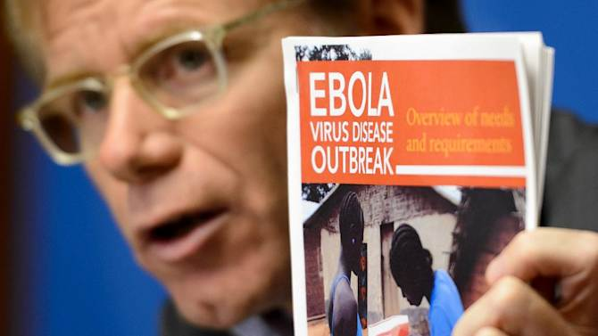 WHO Assistant Director General Bruce Aylward holds a report about Ebola during a press conference on September 16, 2014, in Geneva, Switzerland