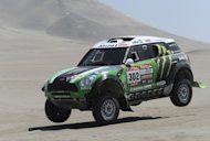France's driver Stephane Peterhansel steers his Mini during the 2012 Dakar Rally Stage 13 Nasca-Pisco, in Peru, on January 14, 2012. The rally gets under way in South America this weekend, amid concern over potential damage to the local environment