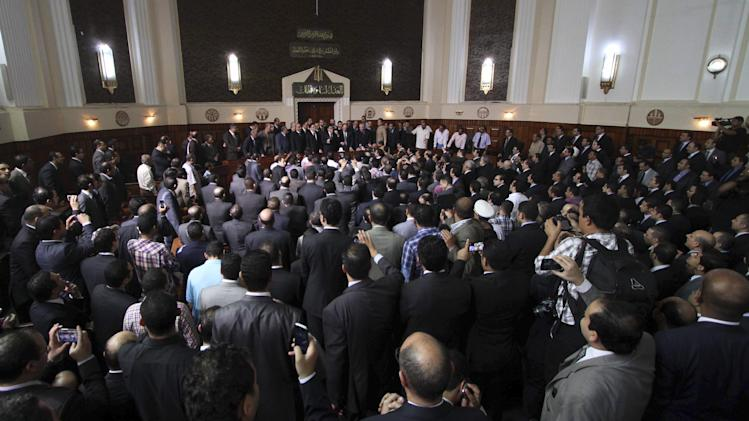 Egyptian Prosecutor General Abdel-Meguid Mahmoud speaks to hundreds of supporters, judges, lawyers and media in a downtown courthouse defying a presidential decision to remove him from his post, saying this infringes on the judiciary's independence, in Cairo, Egypt, Saturday, October 13, 2012. President Mohammed Morsi ordered Prosecutor General Abdel-Meguid Mahmoud to step down to appease public anger over the acquittals of ex-regime officials accused of orchestrating violence against protesters last year. (AP Photo/Ahmed Gomaa)