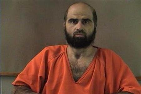 Nidal Hasan, charged with killing 13 people and wounding 31 in a November 2009 shooting spree at Fort Hood, Texas, is pictured in an undated Bell County Sheriff&#39;s Office photograph. REUTERS/Bell County Sheriff&#39;s Office/Handout