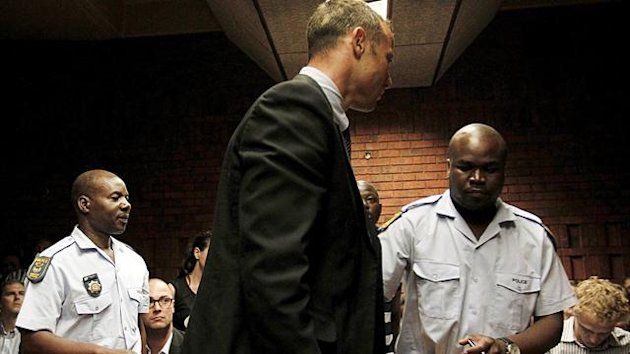 South African 'Blade Runner' Oscar Pistorius (C) is escorted by police during his court appearance in Pretoria February 15, 2013 (Reuters)