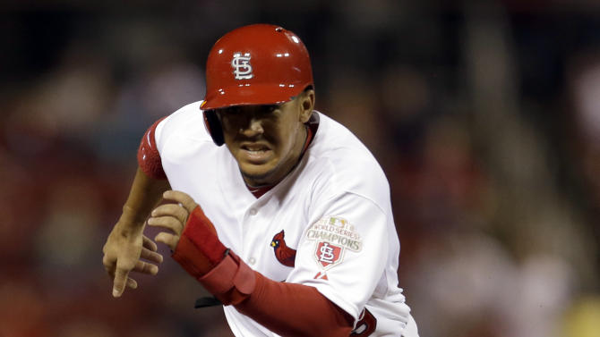 St. Louis Cardinals' Jon Jay prepares to round third and head for home to score on a double by teammate Matt Carpenter during the first inning of a baseball game against the Milwaukee Brewers, Friday, Sept. 7, 2012, in St. Louis. (AP Photo/Jeff Roberson)