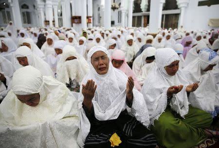 Acehnese women attend a mass prayer for the 2004 tsunami victims at Baiturrahman Grand Mosque in Banda Aceh
