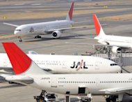 Japan Airlines (JAL) planes taxi on the tarmc at Tokyo's Haneda airport. Japan Airlines, the flag-carrier that went bust in one of the nation's biggest-ever bankruptcies, is aiming to re-list its shares by September, the Nikkei business daily reported Friday