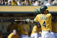 Coco Crisp of the Oakland Athletics swings and watches the flight of the ball as he hits an RBI two-run double in the fourth inning against the Texas Rangers at O.co Coliseum, on October 3, in Oakland, California. The Athletics routed the Rangers 12-5 to secure MLB American League West title for the first time in six years