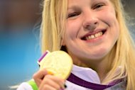 Lithuania's Ruta Meilutyte poses with her gold medal after the podium ceremony for the women's 100m breaststroke swimming event at the London 2012 Olympic Games in the Aquatics Centre at the Olympic Park in London. Meilutyte's young life has been turned upside down since her career-changing Olympic gold medal triumph and has become recognisable in the athletes village in London