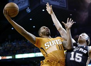 Suns roll past road-weary Spurs 106-85