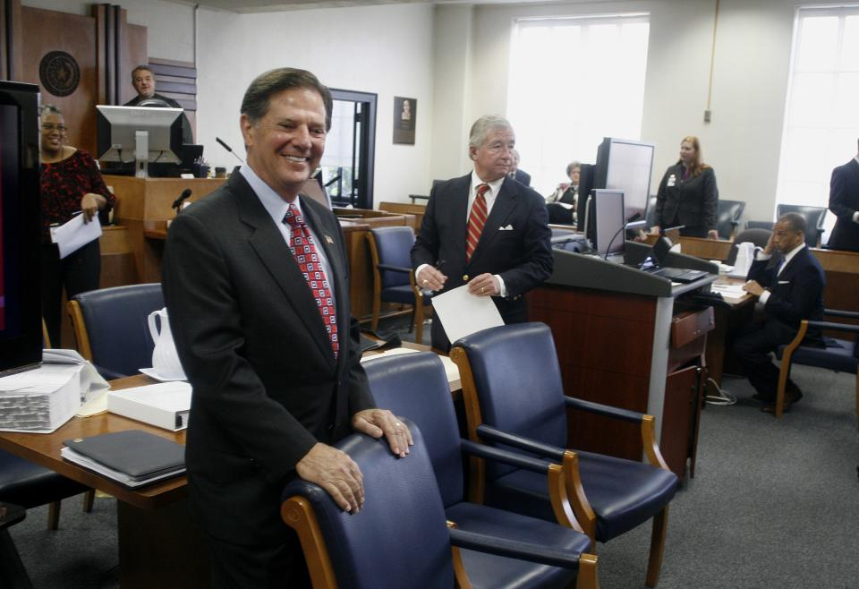 Former House Majority Leader Tom DeLay smiles inside the Travis County courthouse in Austin, Texas on Tuesday, Oct. 26, 2010 before the start of jury selection in his corruption trial. The 63-year-old DeLay is charged with money laundering and conspiracy to commit money laundering. (AP Photo/Jack Plunkett)