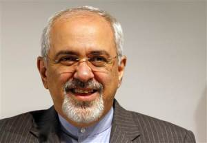Iranian Foreign Minister Mohammad Zarif smiles during a news conference after nuclear talks at the United Nations European headquarters in Geneva