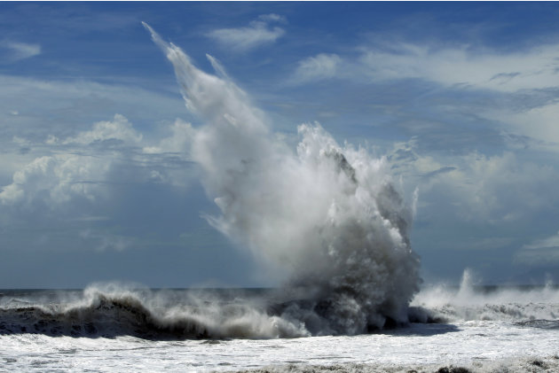 Strong waves batter breakwaters from approaching Typhoon Tembin in the coastal village of Ilan, Taiwan, Thursday, Aug. 23, 2012.  More than 1,000 residents were evacuated from mountainous areas of Tai