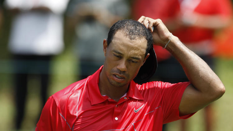 Tiger Woods of the United States reacts on the ninth hole during the final of CIMB Classic golf tournament at the Mines Resort and Golf Club in Kuala Lumpur, Malaysia, Sunday, Oct. 28, 2012.  (AP Photo/Vincent Thian)