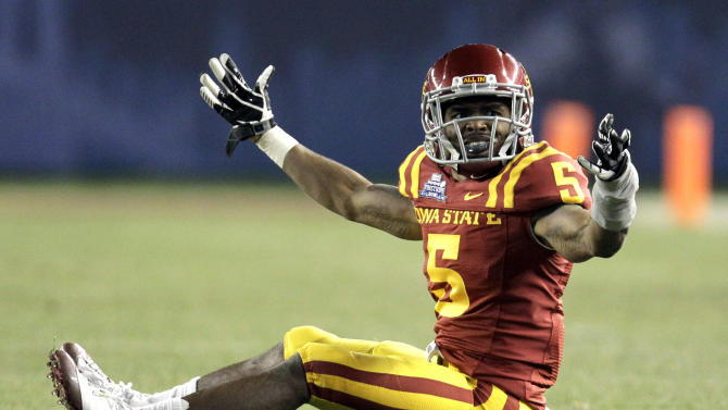 Iowa State defensive back Jeremy Reeves (5) reacts in the third quarter of the Pinstripe Bowl NCAA college football game against Rutgers, Friday, Dec. 30, 2011, at Yankee Stadium in New York. Rutgers won 27-13. ( AP Photo/Julio Cortez)