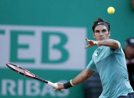 Federer of Switzerland hits a return to Uruguay's Cuevas during their ATP World Tour Istanbul tennis tournament singles final tennis match in Istanbul