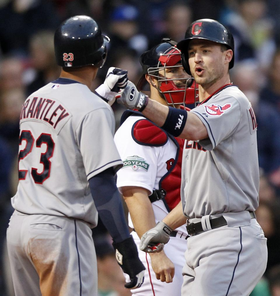 Cleveland Indians' Jack Hannahan, right, celebrates his two-run home run that drove in Michael Brantley (23) as Boston Red Sox catcher Kelly Shoppach, rear, watches in the second inning of a baseball game in Boston, Thursday, May 10, 2012. (AP Photo/Michael Dwyer
