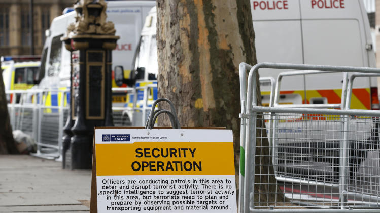 A sign is displayed by the road side warning of a British police security operation taking place along the forthcoming London Marathon route in London, Tuesday, April 16, 2013. British police are reviewing security plans for Sunday's London Marathon, the next major international marathon, because of the bombs that killed three people at the marathon in Boston Monday. (AP Photo/Sang Tan)